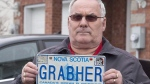 Lorne Grabher displays his personalized licence plate in Dartmouth, N.S. on Friday, March 24, 2017. (Andrew Vaughan/The Canadian Press)