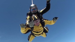 In this grab taken from video, Verdun Hayes gestures as he tandem skydiving, in Devon, England, Sunday, May 14, 2017. (Skydive.buzz via AP)