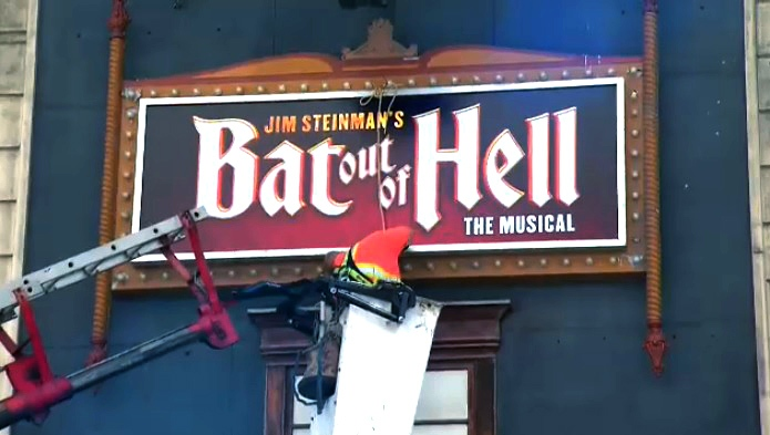 Crews put up a 'Bat Out of Hell: The Musical' sign on Ed Mirvish theatre on May 15, 2017.