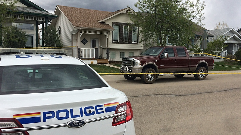 Red Deer RCMP remained at a home in the Lancaster neighbourhood Monday, May 15, 2017 - a 39-year-old man and his 6-year-old daughter were found dead inside on Sunday, May 14, 2017.
