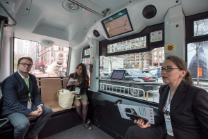 Passengers ride an autonomous bus for a short ride Monday, May 15, 2017 in Montreal. (Paul Chiasson/The Canadian Press)