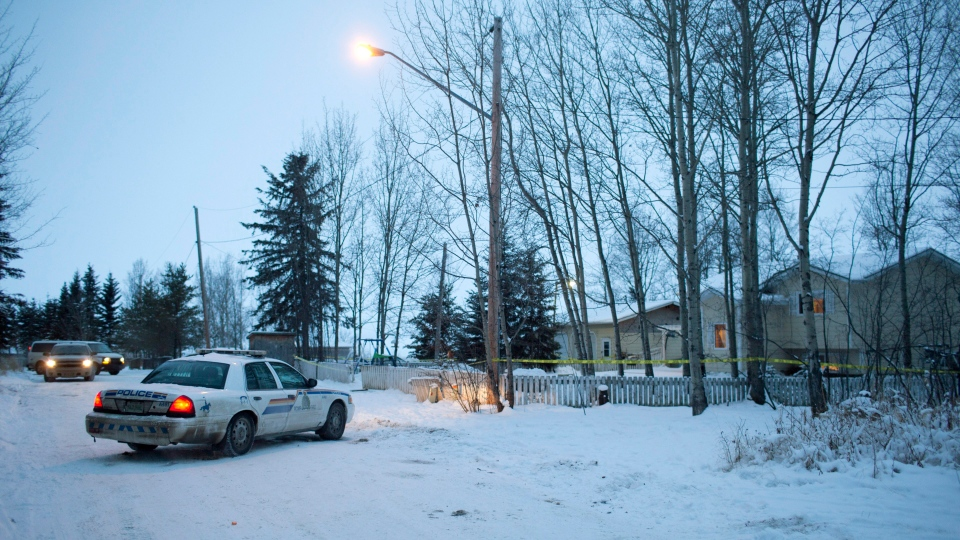 Police investigate at a house Saturday, Jan. 23, 2016 where two people were killed Friday before the shooting at the La Loche, Sask., junior and senior high school. THE CANADIAN PRESS/Jason Franson
