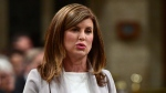 Interim Conservative Leader Rona Ambrose is given a standing ovation as she stands to ask a question during question period in the House of Commons on Parliament Hill in Ottawa on Tuesday, May 16, 2017. THE CANADIAN PRESS/Sean Kilpatrick