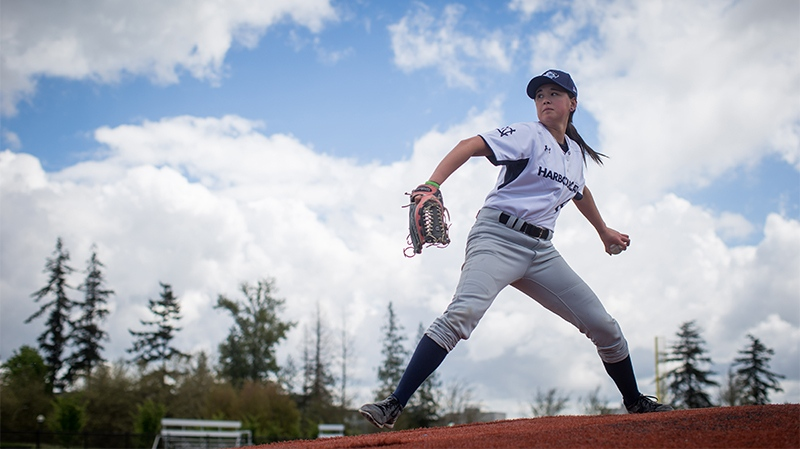 Claire Eccles, 19, pitches while posing for a photograph at the University of British Columbia in Vancouver, B.C., on Friday May 12, 2017. (Darryl Dyck/THE CANADIAN PRESS)