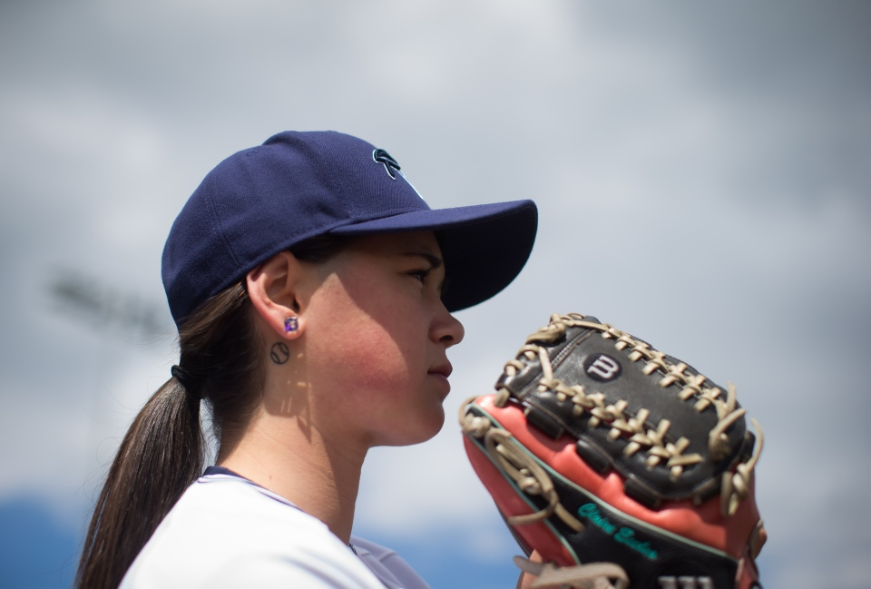 Pitcher Claire Eccles, 19, sports a tattoo of a baseball behind her right ear as she poses for a photograph at the University of British Columbia in Vancouver, B.C., on May 12, 2017. (Darryl Dyck/THE CANADIAN PRESS)