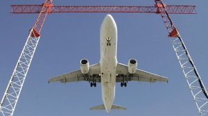 An Air Canada flight makes its final approach as it lands at Pearson International Airport in Toronto. (Adrian Wyld/The Canadian Press)