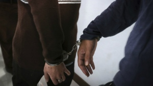 Two men accused of having gay sex are handcuffed as they arrive at the Shariah court in Banda Aceh, Indonesia on Wednesday, May 17, 2017. (AP / Heri Juanda)