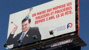 Montreal police brotherhood set up four of these banners around Montreal (photo: CTV Montreal / Wayne Toplosky)