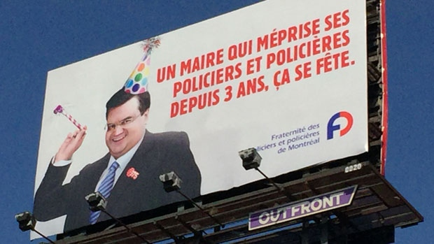 Montreal police brotherhood set up four of these banners around Montreal (photo: CTV Montreal / Wayne Toplosky)