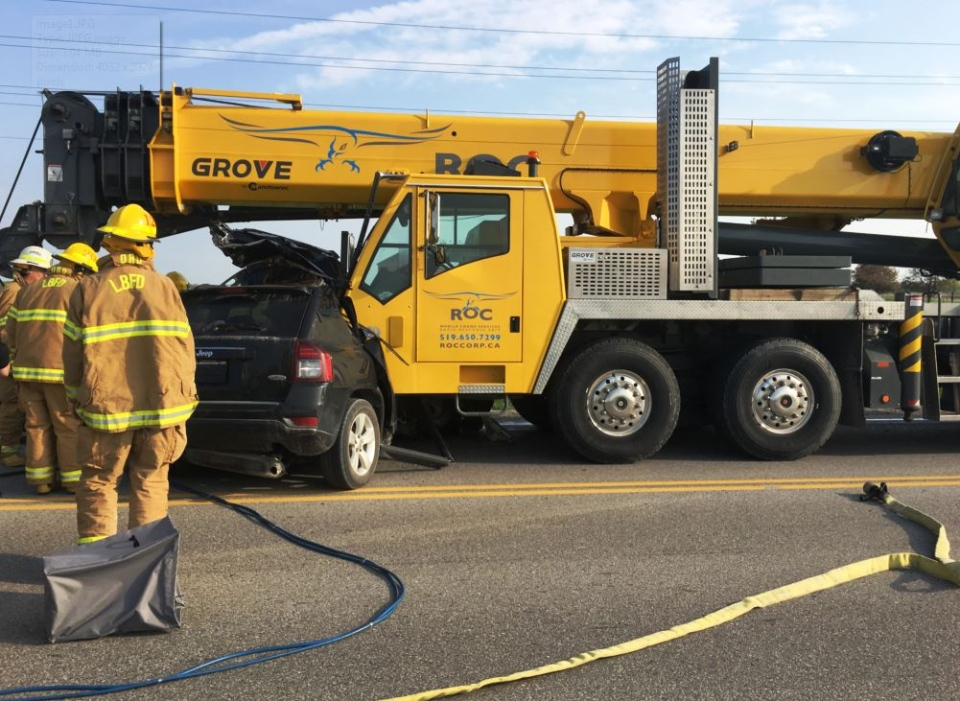 OPP say a female driver is dead after a violent collision involving a small SUV and a crane in Middlesex County on Wednesday, May 17, 2017. (Courtesy OPP)