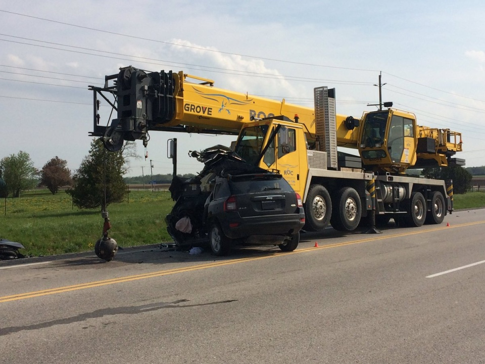 OPP say a female driver is dead after a violent collision involving a small SUV and a crane in Middlesex County on Wednesday, May 17, 2017. (Sean Irvine / CTV London)