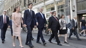 The Prime Minister Justin Trudeau and Ms. Gregoire Trudeau walk with Premier of Quebec Philippe Couillard and Mayor Coderre to the Notre-Dame Basilica to attend a mass marking the 375th anniversary of the founding of Montreal on Wednesday May 17, 2017. THE CANADIAN PRESS/Paul Chiasson