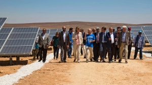 Officials from the IKEA Foundation, and the U.N. refugee agency tour a newly inaugurated solar energy plant, that will provide about 20,000 Syrian refugees with electricity, in the Azraq Refugee Camp, Jordan, Wednesday, April 17, 2017. (Elena Boffetta/AP Photo)