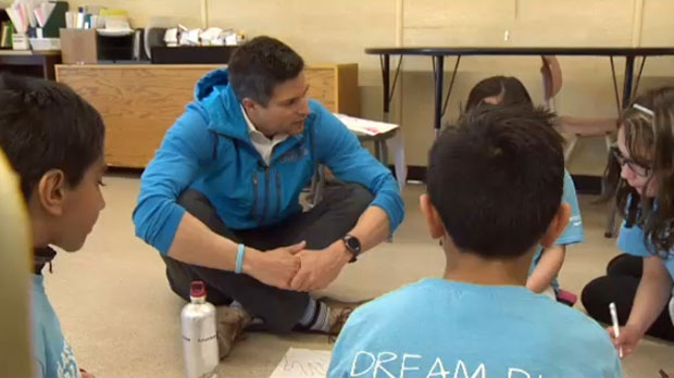 Steve Mesler, an Olympic gold medallist,  talks with Guy Weadick students involved with the Classroom Champions program