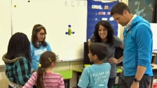 World class athletes Steve Mesler and Michelle Salt with students at Guy Weadick School during Classroom Champions