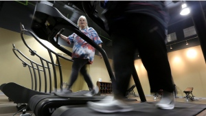 Gym members use as treadmill to warm up for a morning exercise class at Downsize Fitness Thursday, Jan. 3, 2013, in Addison, Texas. (LM Otero/AP Photo)