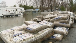 Sandbags surround a home in a flood zone in Quebec