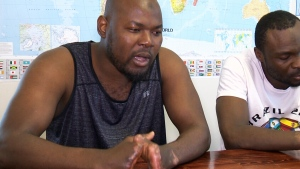 Razak Iyal, (left) and Seidu Mohammed, 24, (right) have formed a tight bond over their painful recoveries and their shared desire to permanently join the community they risked their lives to reach.