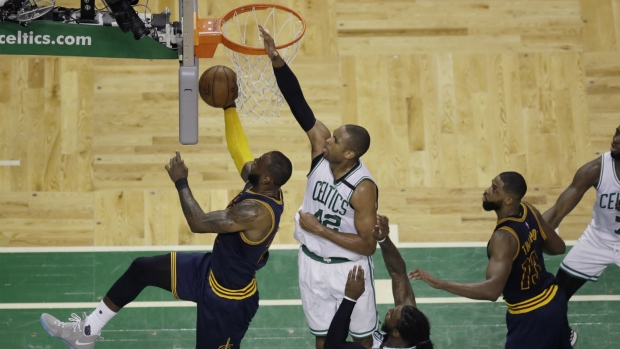 LeBron leads rout of Celtics in playoff action