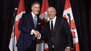 Conservative Party leadership candidate Maxime Bernier, left, shakes hands with Kevin O'Leary at a news conference in Toronto on April 26, 2017. (Nathan Denette/THE CANADIAN PRESS)