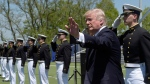 U.S. President Donald Trump waves at the U.S. Coast Guard Academy in New London, Conn., on May 17, 2017. (Susan Walsh / AP)