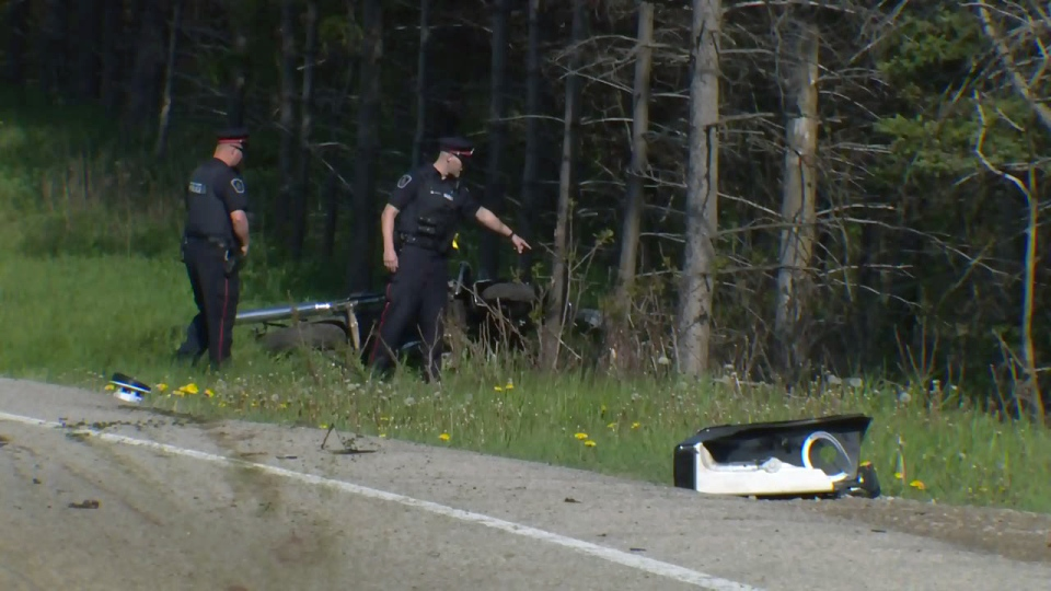 Police officers investigate a serious crash involving a motorcycle and a deer on Weimar Line on Thursday, May 18, 2017.