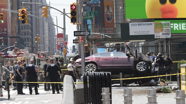 A car rests on a security barrier in New York's Times Square after driving through a crowd of pedestrians, injuring at least a dozen people, Thursday, May 18, 2017. (Source: Mary Altaffer/AP Photo)