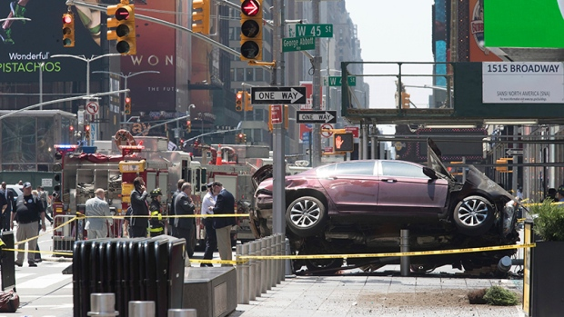 Man charged with murder after car mows down pedestrians in Times Square