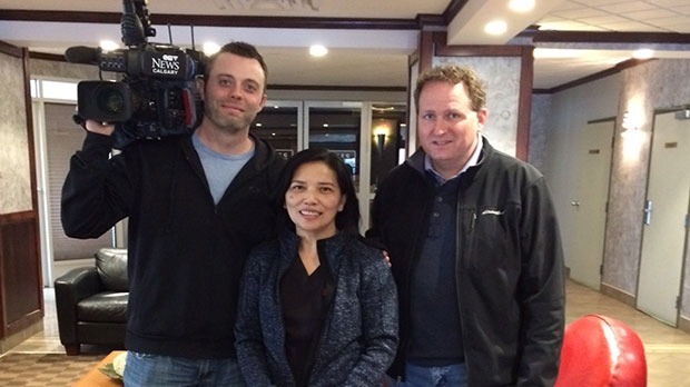 CTV Calgary news photographer Richard Blais (left), Fort McMurray evacuee Helen Corre Zaza (centre), and CTV Calgary news reporter Shaun Frenette (right).