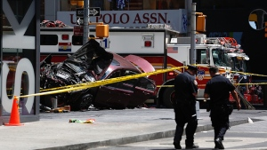 A smashed car sits on the corner of Broadway and 45th Street in New York's Times Square after ploughing through a crowd of pedestrians at lunchtime on Thursday, May 18, 2017. (AP Photo/Seth Wenig)