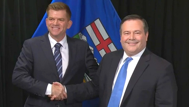 Wildrose Leader Brian Jean and Progressive Conservative Leader Jason Kenney shake hands after signing an agreement-in-principle in Edmonton on Thursday, May 18, 2017.