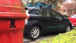 An Evo car is parked illegally in front of a fire hydrant. (CTV)