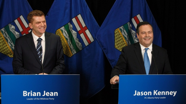 Alberta Wildrose leader Brian Jean and Alberta PC leader Jason Kenney announce a unity deal between the two in Edmonton on Thursday, May 18, 2017. (Jason Franson/The Canadian Press)
