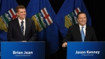 Alberta Wildrose leader Brian Jean and Alberta PC leader Jason Kenney announce a unity deal between the two in Edmonton on Thursday, May 18, 2017. THE CANADIAN PRESS/Jason Franson