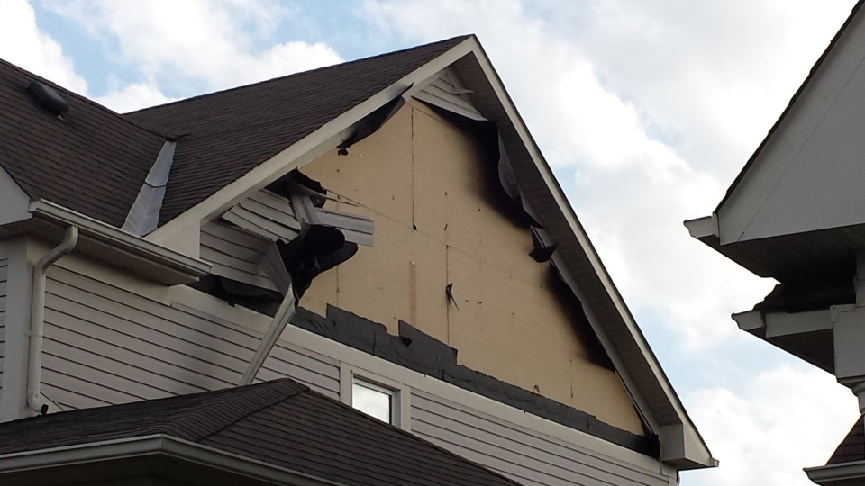 Winds tore siding from a home in Barrie, Ont. on Thursday, May 18, 2017. (Rich Williamson/ Twitter)