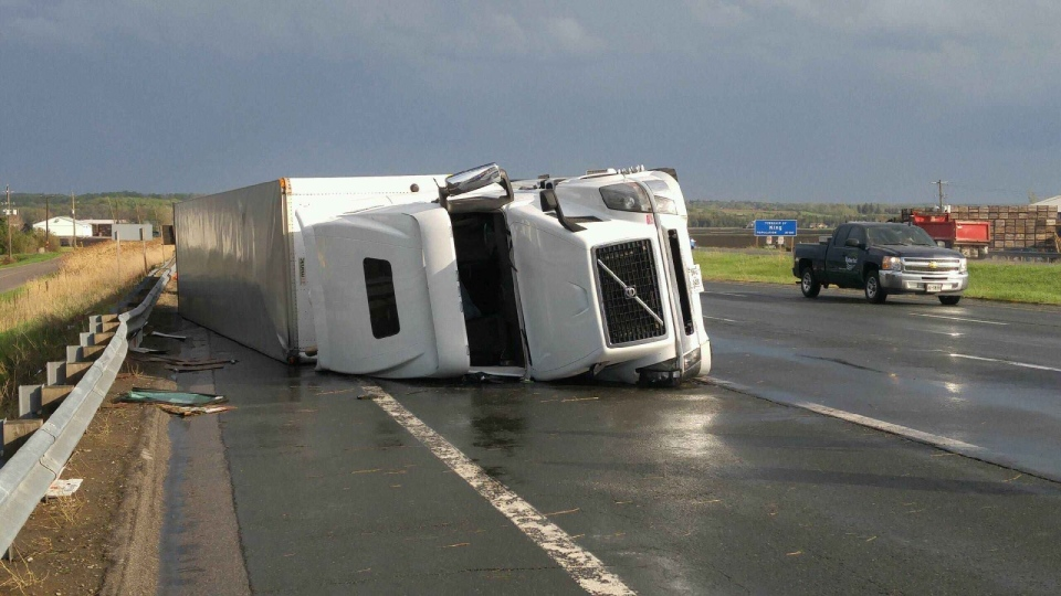 A transport truck flipped on Highway 400 in King Township, Ont. during a thunderstorm on Thursday, May 18, 2017. (Sgt. Kerry Schmidt/ Twitter)