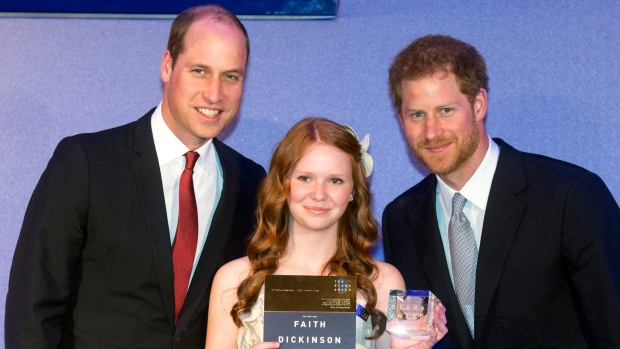 Britain's Prince Harry, right, and Prince William give an award to Faith Dickinson from Ontario during a ceremony The Diana Award's inaugural Legacy Award, at St James' Palace in London, Thursday, May 18, 2017. (Paul Grover / Pool Photo via AP)