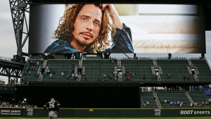 A tribute to singer Chris Cornell is shown on a video display at Safeco Field in Seattle before a baseball game between the Seattle Mariners and the Chicago White Sox, Thursday, May 18, 2017. (AP / Ted S. Warren)