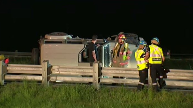 Emergency crews work at the scene of a rollover crash on Highway 7/8 near Trussler Road.