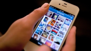This April 9, 2012, file photo shows Instagram being demonstrated on an iPhone in New York. (Karly Domb Sadof/AP)