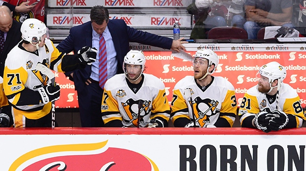 Pittsburgh Penguins head coach Mike Sullivan, centre Evgeni Malkin (71) centre Matt Cullen (7) \right wing Carter Rowney (37) and right wing Phil Kessel (81) look on during a stoppage in play first period of game three of the Eastern Conference final in the NHL Stanley Cup hockey playoffs against the Ottawa Senators in Ottawa on Wednesday, May 17, 2017. THE CANADIAN PRESS/Sean Kilpatrick
