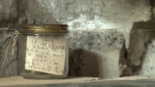 Jar with notes found in fireplace.