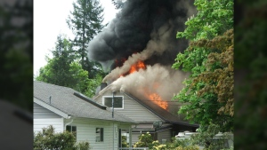 A Campbell River home occupied by a family of eight is likely a total write-off after a massive fire broke out Friday afternoon. May 19, 2017. (Photo courtesy Campbell River Mirror/Steve Ostler)
