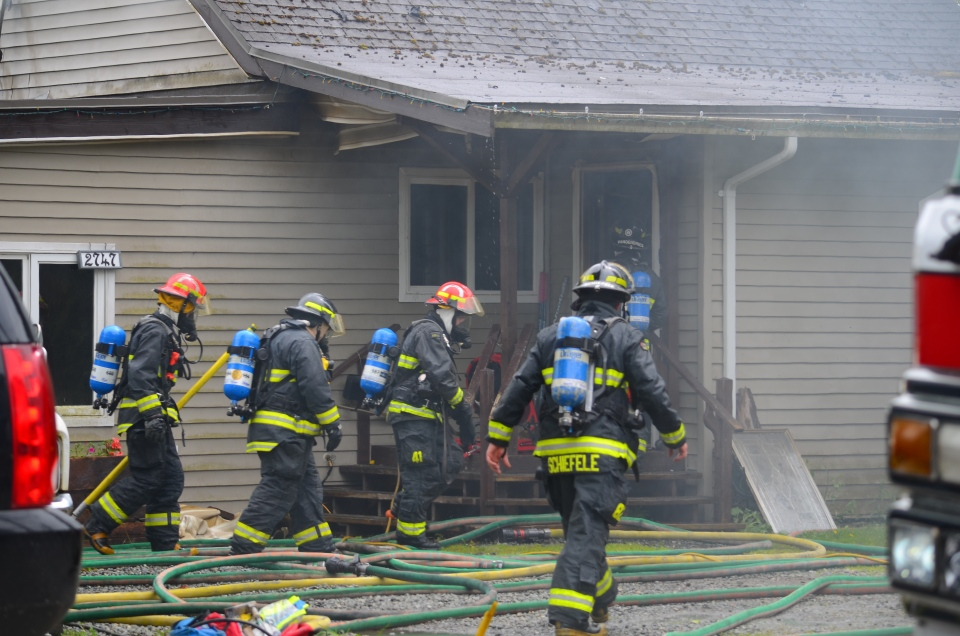 A Campbell River home occupied by a family of eight is likely a total write-off after a massive fire broke out Friday afternoon. May 19, 2017. (Photo courtesy Alistair Taylor/Campbell River Mirror)