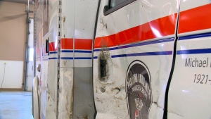 A Parkland ambulance sits damaged in Prince Albert, days after an SUV the ambulance service says was driving in the wrong lane with no headlights on crashed into the emergency vehicle.