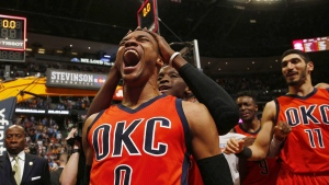 Oklahoma City Thunder guard Russell Westbrook celebrates after hitting a buzzer beater 3-pointer to win the NBA basketball game against the Denver Nuggets in Denver on Sunday, April 9, 2017. (AP / Jack Dempsey)