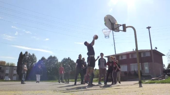 Kids on Husson Place are seen on May 16, 2017 playing with the basketball net that is set to be taken down . (CTV Kitchener)