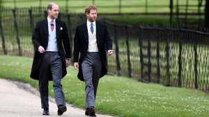 Prince William, left, and his brother Prince Harry arrive for the wedding of Pippa Middleton and James Matthews at St Mark's Church in Englefield Saturday, May 20, 2017.