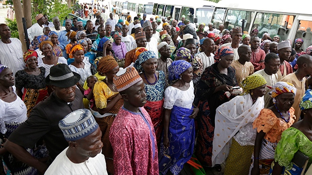 Parents of the kidnapped schoolgirls wait to be transported to they venue where they will be reunited with their daughters, in Abuja, Nigeria, Saturday, May 20, 2016.  (AP Photo/Sunday Alamba)