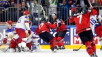 Canada's players celebrate a goal by Canada's Ryan O'Reilly, no.90 center background, at the Ice Hockey World Championships semifinal match between Canada and Russia in the LANXESS arena in Cologne, Germany, Saturday, May 20, 2017. (AP Photo/Petr David Josek)